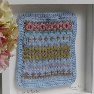 Fairisle knit sample in frame