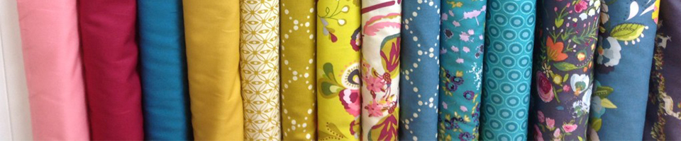 A selection of colourful fabric rolls
