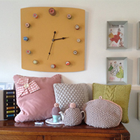 Cushions, a clock, a tea cosy and a boiled egg cosy