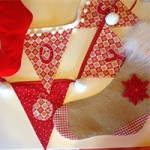 A photo of Christmas bunting and stockings