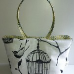 soft handbag with birdcage design on front
