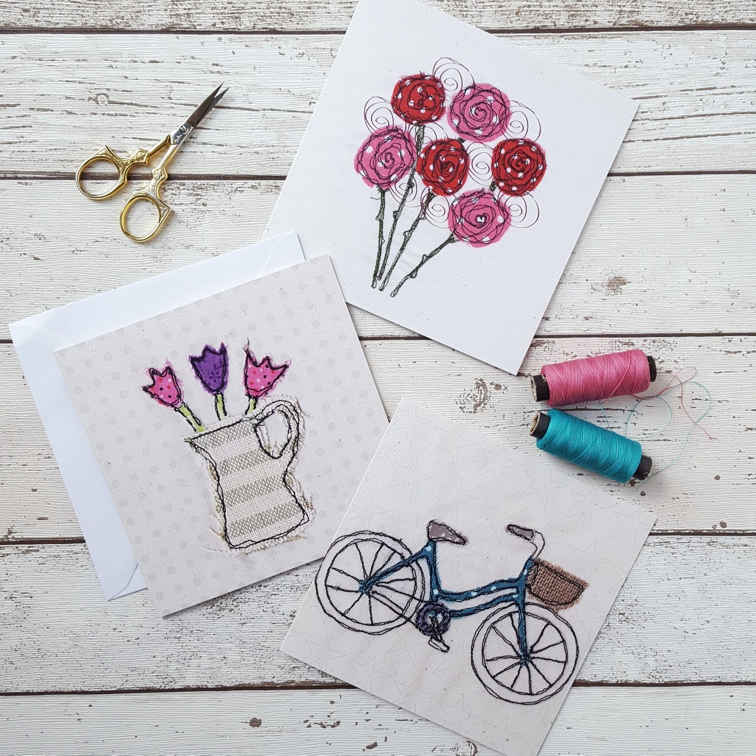 . Fabric stitched to cards. Bicycle, flowers in jug, bunch of flowers