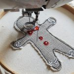 Free motion sewing a gingerbread man in fabric