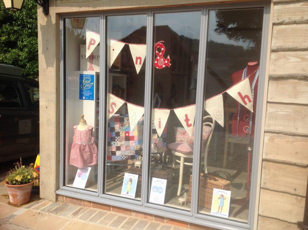 large shop window of sewing school
