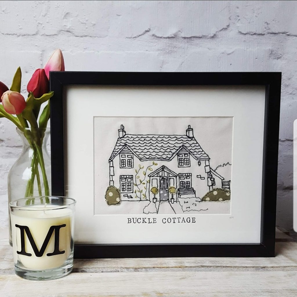 Black and white stitched picture of buckle cottage
